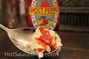 Dave's Gourmet Ghost pepper naga Jolokia Hot sauce On food
